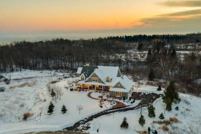 Sunrise aerial photo of gorgeous home set off of Lake Michigan.